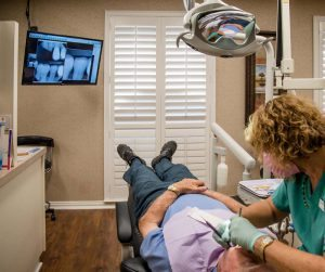 Hygienist working on patient